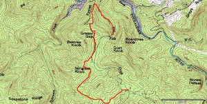 3 miles via the circuitous route that must be taken, to avoid a vertical cliff rappel that is